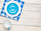 Empty plate, cup and towel