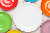 Colorful plates over wooden table