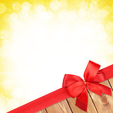 Red ribbon with bow over christmas snow background