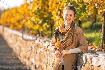 Portrait of smiling young woman in autumn park