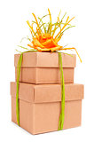gift boxes tied with natural raffia of different colors and topp
