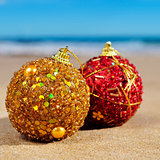 ornamented christmas balls on the beach