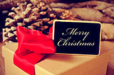 gift and signboard with the text merry christmas