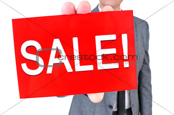 man in suit with a signboard with the text sale