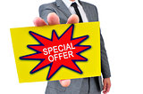 man in suit with a signboard with the text special offer