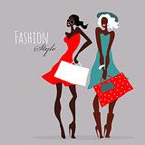Fashion girls. Women with shopping bags.