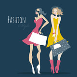 Fashion girls. Women with shopping bags.