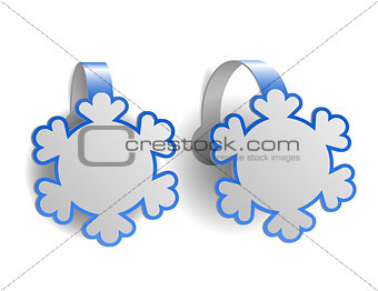 Blue advertising wobblers shaped like snowflakes