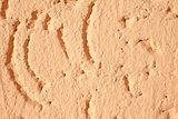 closeup bacgrkound texture of an light orange plaster