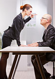 business woman violently facing a business man