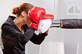boxing business woman defending from a punch