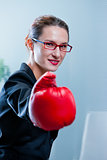 winning business woman with a red box glove