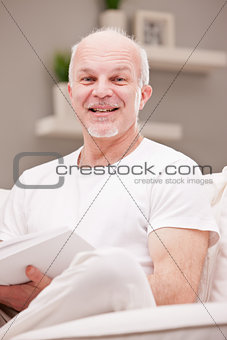 portrait of smiling man on a couch