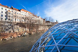 Graz city seen from Island on Mur river connected by a modern st