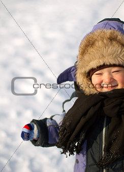 Little Boy Having Fun in winter
