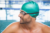 Close up of a fit swimmer in the pool