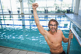 Portrait of a fit swimmer cheering in the pool