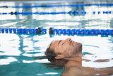 Close-up side view of a fit swimmer in the pool