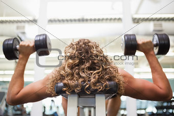 Close up of a man exercising with dumbbells