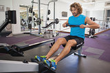 Man using resistance band in gym