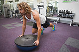 Man doing crossfit fitness workout in gym