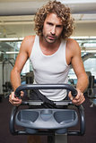 Fit man using exercise bike