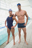 Fit couple swimmers by the pool at leisure center