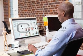 Businessman looking at computer monitor