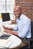 Portrait of businessman using computer