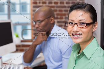 Smiling female photo editor in office