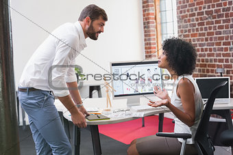 Photo editors in discussion at office