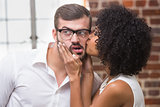 Woman kissing man in office