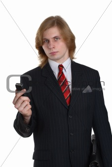a businessman in a black suit with a telephone