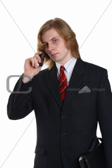 a businessman in a suit talking telephone