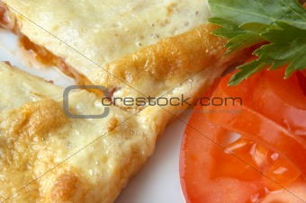 flat omelet with tomato slice