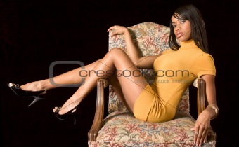 Glamorous black girl in chair