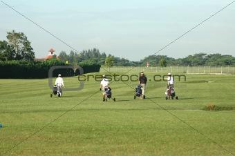 4 Golf Players