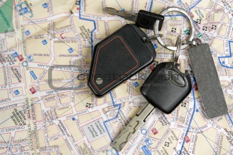 Old car keys on a map.
