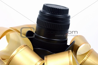 Camera lens rapped in golden band