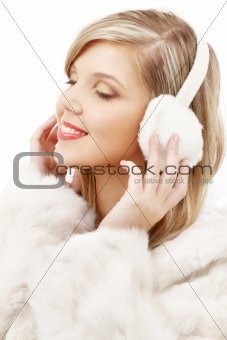 smiling blond in furry headphones