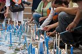 Devotees lighting candles.