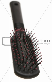 Black hairbrush on a white background