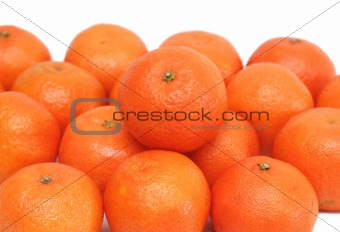 A lot of ripe tasty a tangerine on a white background
