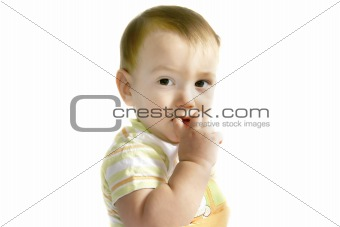 baby boy with finger in his mouth over white