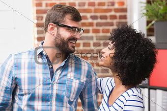 Casual man and woman looking at each other