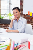 Portrait of smiling female executive at desk