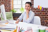 Portrait of female executive at desk