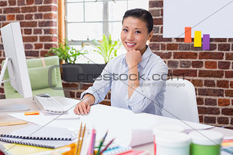 Portrait of female executive at desk
