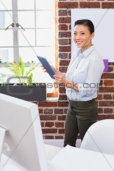 Portrait of businesswoman using digital tablet in office