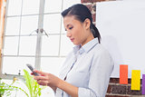 Concentrated businesswoman using digital tablet in office